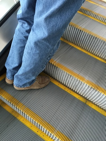 man: Man going up escalator