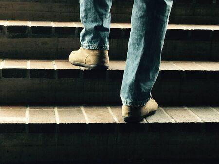 up: Man walking up stairs Stock Photo