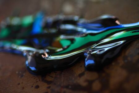 curving lines: Closeup view of blue green and black paint Stock Photo