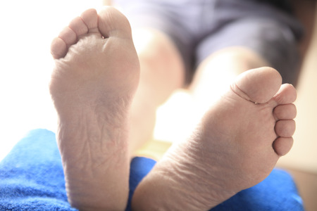 Closeup view of two feet of a man with his legs propped up