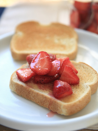 macerated: Macerated strawberries on toast for a healthy breakfast or snack