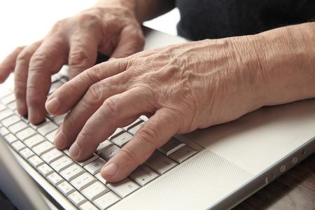 Senior man works at his computer.