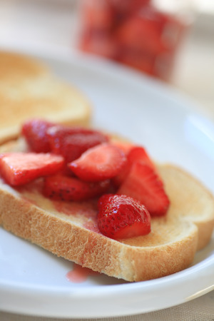 macerated: Toast with macerated sweetened strawberries closeup Stock Photo