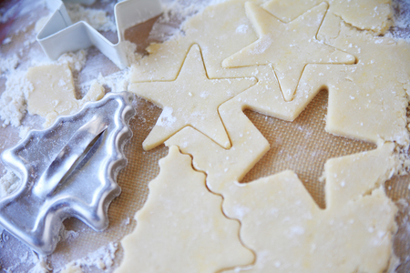 cookie cutters: Using star and tree cookie cutters on sugar cookie dough