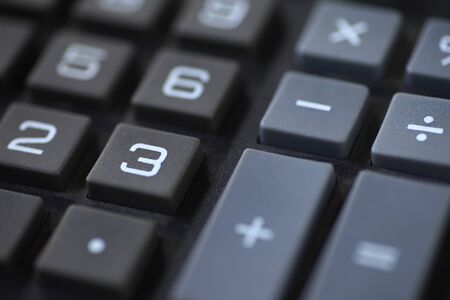multiplying: Numbers and symbols on a desk calculator