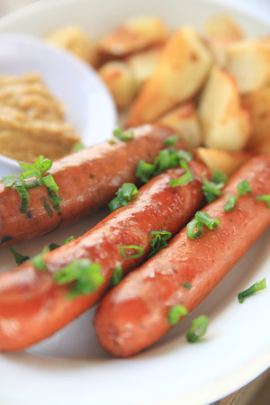 scallions: Sausages with chopped scallions and home-fried potatoes with mustard