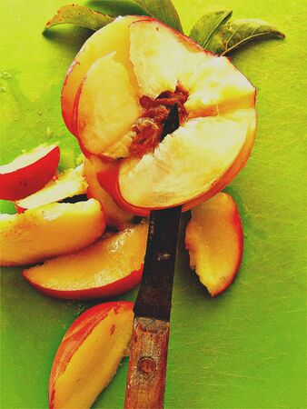 paring knife: Fresh summer fruit with a paring knife from overhead