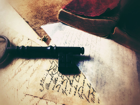 old papers: Large key on old papers with leather-covered vintage book
