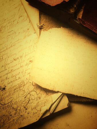 script writing: Old papers with script writing and a vintage book with copy space Stock Photo