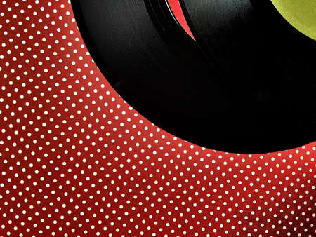 Two vinyl records on a polka dot background