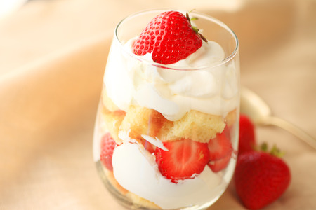 trifle: Miniature strawberry trifle in a drinking glass with whipped cream and pound cake cubes