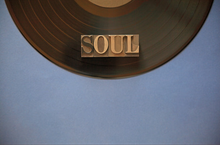aural: Black vinyl record with the word soul in metal type with room for copy