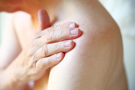 Senior man with shoulder joint pain closeup Banque d'images