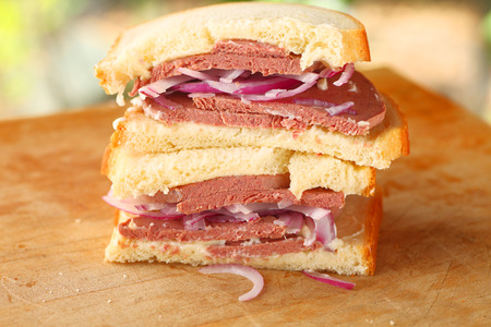 Stacked sandwich halves with braunschweiger, red onions and mayonnaise on buttermilk bread