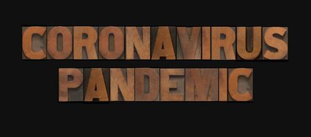 The words coronavirus pandemic in letterpress wood letters Banque d'images