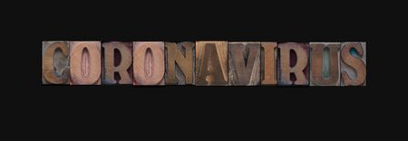 The word coronavirus in wood type letters
