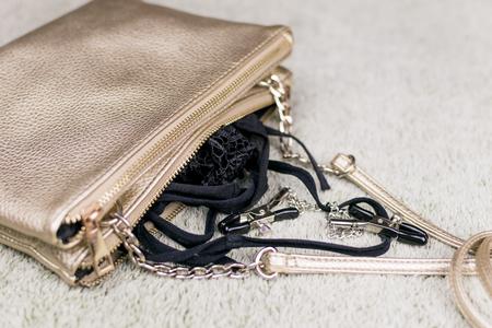 A womens handbag with fallen love toys. Stock Photo