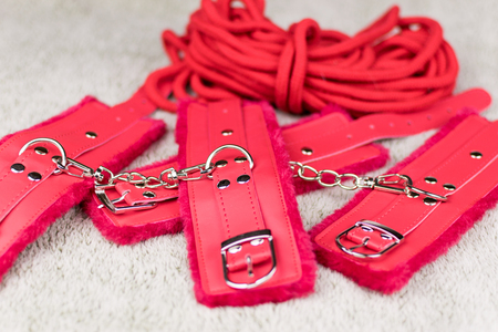 Red straps are handcuffs for love games.