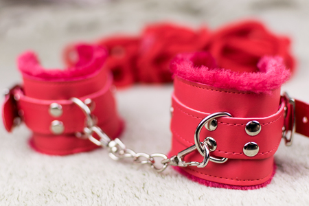 Red handcuffs for love games.