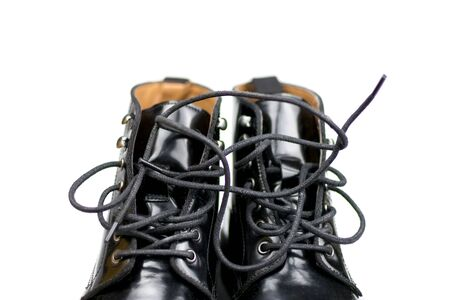 Black shoes with laces. Top part. Isolated on white background.