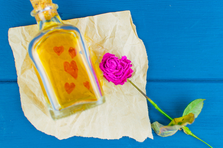 A love potion on paper with painted hearts.