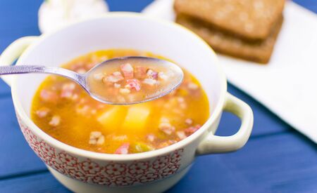 Soup of saltwort. Soup from different types of sausages, olives, potatoes, tomato paste.