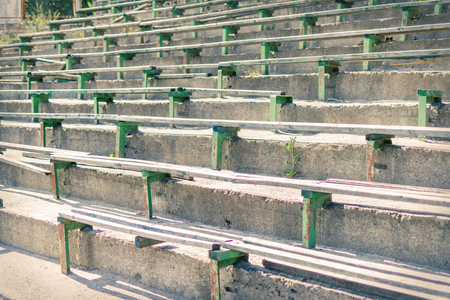Old destroyed rows of seats of an abandoned stadium.