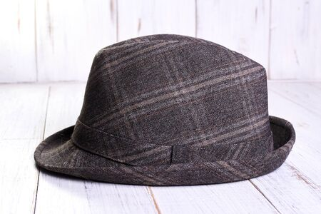 Gray hat on a light wooden background