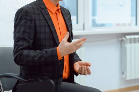 Lecturer conducts a lecture, training.