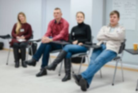 A group of people at a seminar, conference in the blur effect. 版權商用圖片