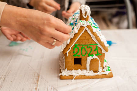 Gingerbread house with numbers 2021. Preparing for the New Year, Christmas.
