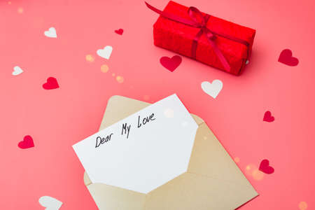 My dear love - the text of the beginning of the letter. Envelope on a red background with hearts. Declaration of love for Valentine's Day.