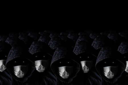 Quarantine, epidemic, lockdown concept. Many identical people in medical masks on a black background.