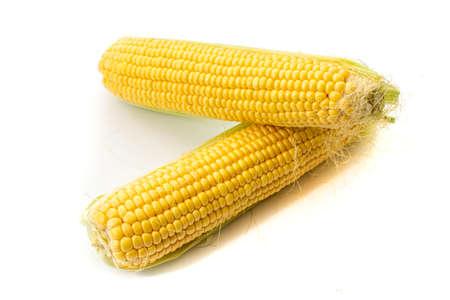 Whole corn isolated on white background.