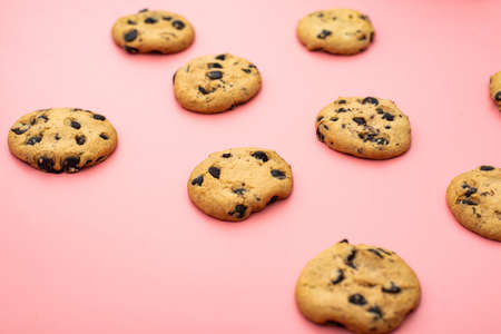 Cookies with chocolate on a pink background. Sweet background.