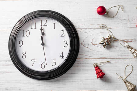 Minute twelve before the New Year. Clock on a white background and Christmas toys. Stok Fotoğraf