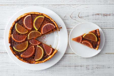 Piece of pumpkin pie on a white plate. Vegetarian baked goods, dessert. Stok Fotoğraf