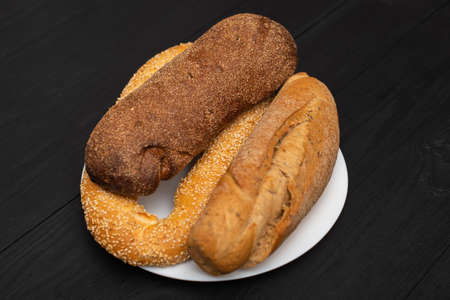Different types of bread on a black background. Stok Fotoğraf