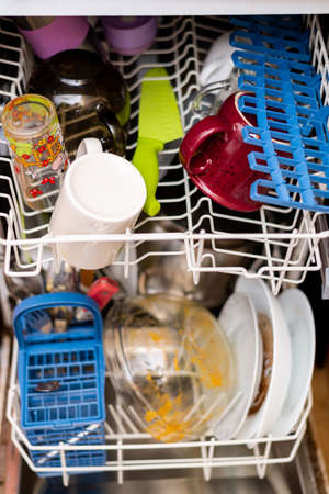 Dirty dishes in the dishwasher. Stock fotó