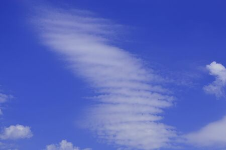 float cloud: plumose white clouds on a blue background