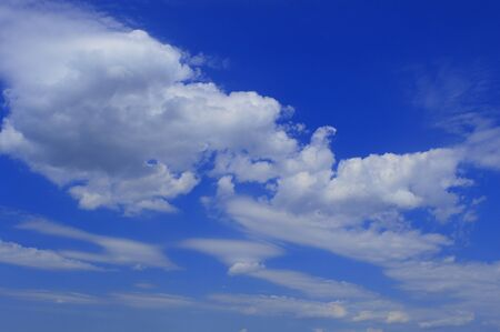 float cloud: transparent plumose clouds in the blue sky