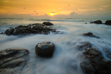 Sea scape with stone beach at Phuket Thailand photo