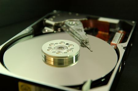 databank: Open hard drive whith shiny plates in a black background
