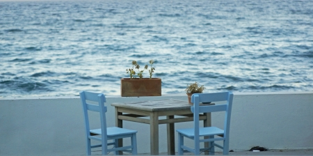 Wooden chair and table by the sea  with flowers