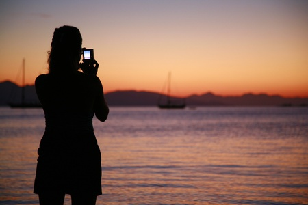 taking photograph: Sunset in Datca with sailboats Stock Photo
