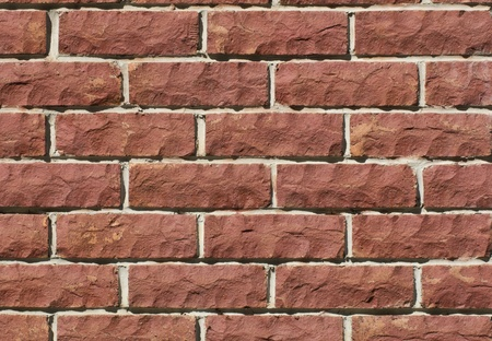 Tiled red stone wall Stock Photo