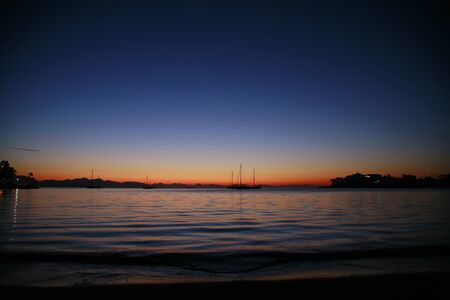 Sunset in Datca with sailboats Stock Photo