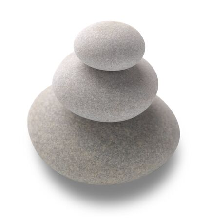 Three pebbles be stacked up on top of each other with selective focus