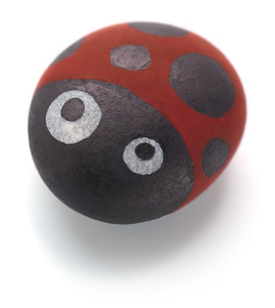Cute ladybird drawing on pebble Stock Photo - 16063238