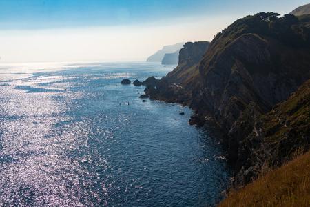 Lulworth cove, south west coast cliffs and sea in Dorset, United Kingdom